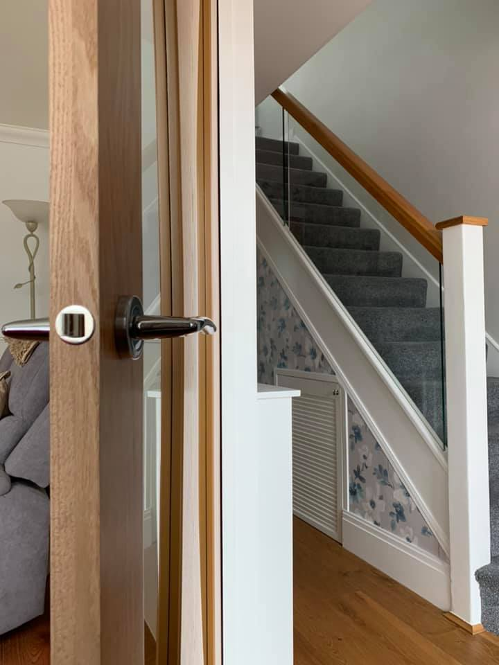 Oak Doors and Glass Staircase